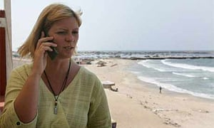 Lauren Booth makes contact with the outside world from Gaza. Photograph: Abid Katib/Getty