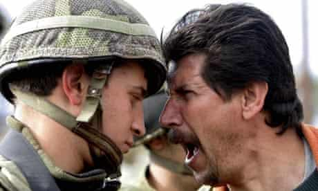 A Palestinian protestor confronts an Isareli soldier