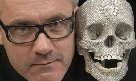 Damien Hirst poses with his diamond encrusted skull, 'For the love of God'