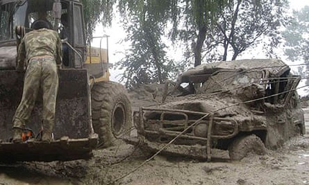 The aftermath of a mudslide brought on by heavy rains in which at 34 people have been killed in China's northern Shanxi province
