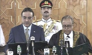 Asif Ali Zardari (l), the widower of former Pakistani prime minister Benazir Bhutto, is sworn in as president in Islamabad in this TV grab.