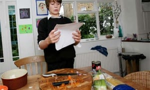 Fergus Mason, 11, attempts to cook spaghetti bolognese from a cookbook aimed at 11 year olds