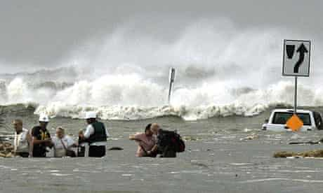 Locals stranded by hurricane Ike await helicopter rescue in High Island, Texas
