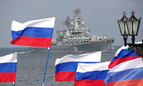 Pro-Moscow supporters welcome the Russian missile cruiser Moskva as it enters Sevastopol Bay on Ukraine's Crimea peninsula