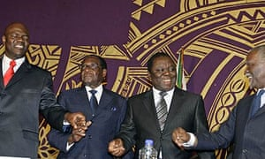 President Robert Mugabe with Morgan Tsvangirai, MDC leader and  the new Prime Minster of Zimbabwe, at the signing of the power sharing deal  ceremony in Harare