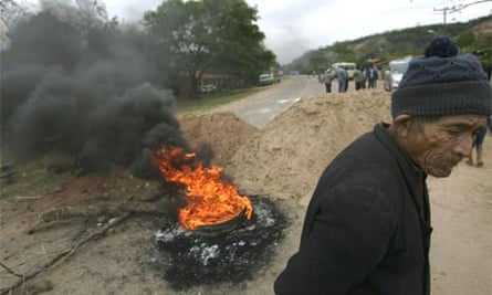 A supporter of Evo Morales at a roadblock during a pro-government protest in Tiquipaya, Bolivia