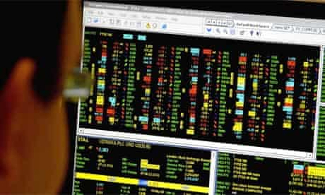An office worker looks at a FTSE 100 trading screen after investors were rocked by the collapse of US bank Lehman Brothers