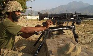 A Pakistan soldier mans a machine gun in the north-western Bajur region in Pakistan