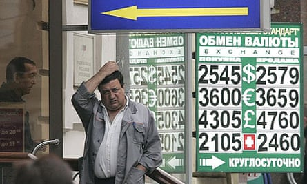 A man outside a currency exchange bureau in central Moscow after Russian shares posted their worst one-day fall in a decade.