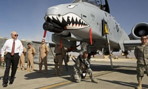 US defence secretary Robert Gates greets aircraft crew on a visit to Afghanistan, where, he says, more troops are needed