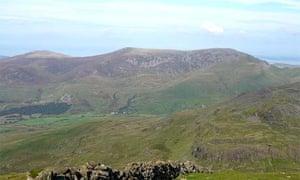 Snowdonia's Nantlle ridge, left to right, in old OS heights: Mynydd Graig Goch (609m), Garnedd Goch (700m) and an unnamed cairn (734m)