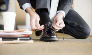 Businessman Adjusting shoe