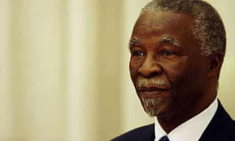 Deposed South African president Thabo Mbeki looks on before addressing his cabinet in Pretoria