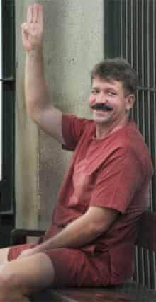 Viktor Bout gestures from his Bangkok court cell