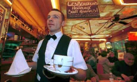 Waiter serving coffee in restaurant in Paris