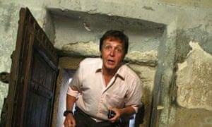 Former Beatles star Paul McCartney walks through the door of the Nativity Church in Bethlehem September 24, 2008