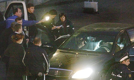 Forensics experts examine the car in which the former Chechen president Ruslan Yamadayev was shot dead  outside the British embassy in central in Moscow