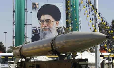 A missile in front of a poster of the Iranian supreme leader Ayatollah Ali Khamenei during a military exhibition in Tehran, Iran