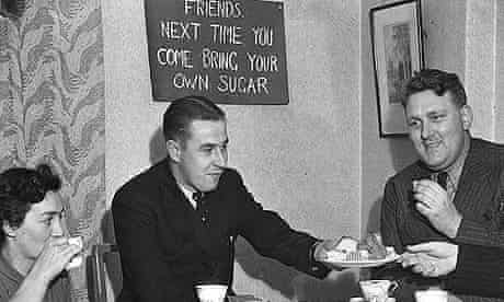 On the eve of the implementation of food rationing in September 1939, visitors to a Manchester home are asked to bring their own sugar when they drop in for a cup of tea.