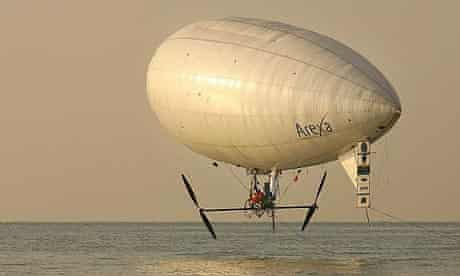 Balloonist Stephane Rousson pedals his airship out over the English Channel