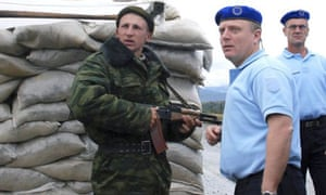 EU monitors at a checkpoint in the Russian buffer zone next to South Ossetia