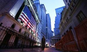 A man walks past the New York Stock Exchange