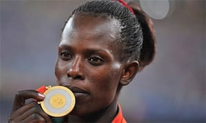 Pamela Jelimo with her gold medal after winning the women's 800m at the Beijing Olympics
