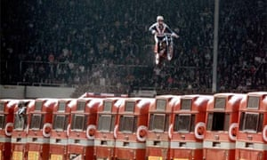 Stuntman Evel Knievel attempting to jump a row of buses, 1975
