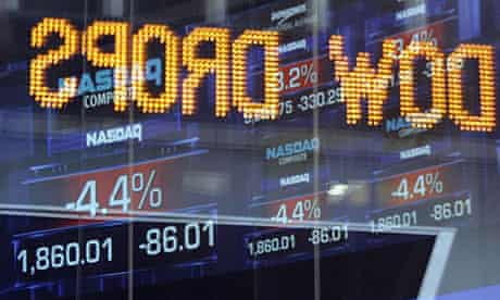 The Dow Jones news ticker is reflected on a window at the NASDAQ building just before the closing bell in New York's Times Square