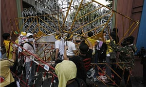 Protesters barricade the gates of the parliament building in Bangkok