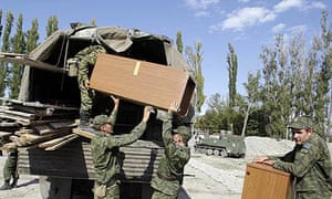 South Odessa, Georgia: Russian soldiers load items on a truck as they dismantle a checkpoint at the Georgian village of Karaleti