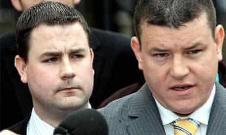 Chris Ward, left, and his solicitor Niall Murphy speak to reporters outside Belfast crown court after Ward was cleared of involvement in the 2004 robbery of Northern Bank