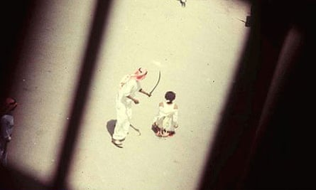 A Saudi executioner prepares to behead a convicted drug dealer in Jeddah in this 1985 image