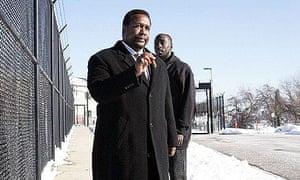 Detective Bunk Moreland (Wendell Pierce) greets Omar Little (Michael K Williams) outside prison