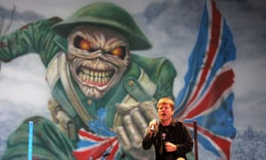 Iron Maiden singer Bruce Dickinson performs beneath an Eddie the Head flag