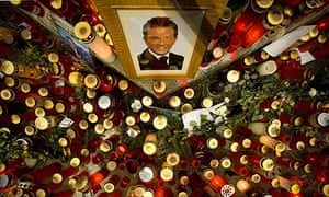 Candles and a photo of Joerg Haider at the site of his fatal car accident in Klagenfurt, Austria