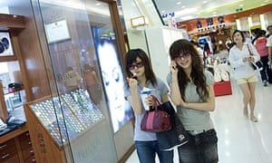 Shoppers in the Ginza Mall in Beijing, China