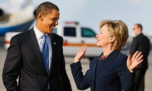 Barack Obama and Hillary Clinton talk after walking off his plane as they head to a campaign rally at Amway Arena in Orlando, Florida