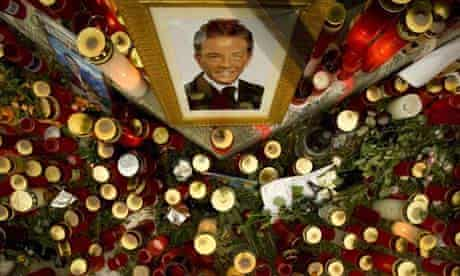 Candles and a photo of Joerg Haider are placed at the site of his fatal car accident in Klagenfurt