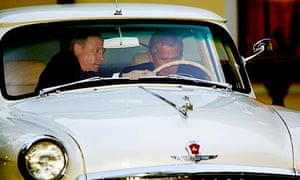 Russian President Vladimir Putin lends some assistance as US president George Bush drives Putin's 1956 Volga