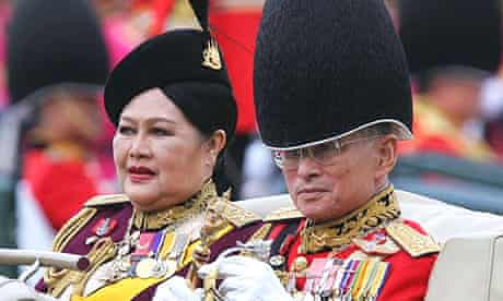 Thailand's King Bhumibol Adulyadej and Queen Sirikit review a guard of honour in Bangkok