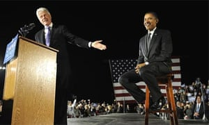Barack Obama sits beside the former US president Bill Clinton during a midnight rally in Osceola Heritage Park in Kissimmee, Florida