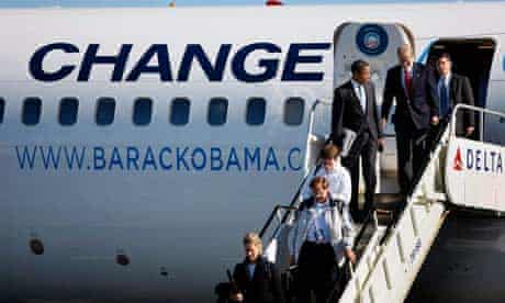 Barack Obama exits his plane with senator Bill Nelson in Florida. Photograph: Joe Raedle/Getty Images