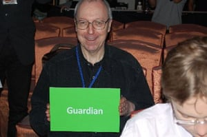 Jack Schofield holds a green card that says Guardian
