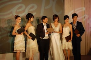 CEO Jerry Shen in bow tie with models