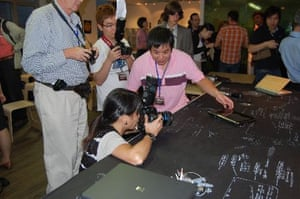 Journalists photographing an S101