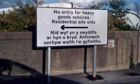 """Welsh-language road sign reading: """"I am out of the office at the moment"""", erected in Swansea"""