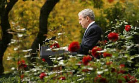 President Bush congratulates president-elect Barack Obama at the White House's rose garden. Photograph: Kevin Lamarque/Reuters