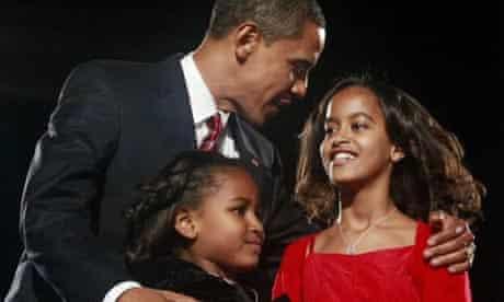 Barack Obama with his daughters Sasha and Malia. Photograph: Jason Reed/Reuters
