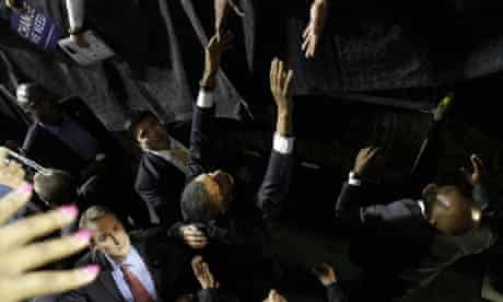 Secret service agents surround Barack Obama as he reaches out to supporters. Photograph: Alex Brandon/AP